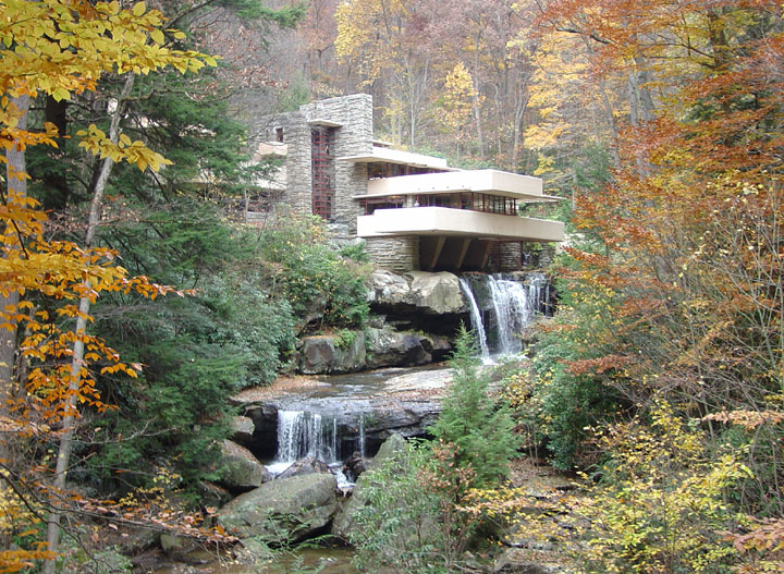 Tucked between autumn foliage is what at first looks to be two waterfalls, slowly descending, then you see the precipice is a multilevel building, with innovative use of planes and angles, enmeshed in the forest scape
